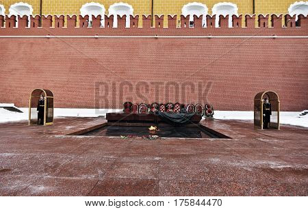 Moscow.Russia February 25.2017: Winter view of the Tomb of Unknown soldier and Eternal flame in Alexander garden near Kremlin wall in Moscow, Russia.