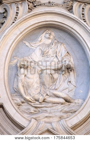 ROME, ITALY - SEPTEMBER 02: Our Lady of Sorrows, bass relief on the facade of Sant Andrea de Urso church in Rome, Italy  on September 02, 2016.