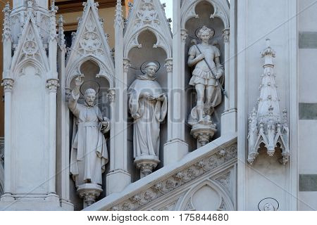 ROME, ITALY - SEPTEMBER 02: Statues of St. Francis Xavier, Dominic of Guzman and Michael Archangel on the facade of Sacro Cuore del Suffragio church in Rome, Italy  on September 02, 2016.
