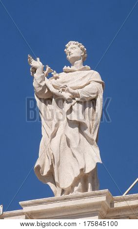 ROME, ITALY - SEPTEMBER 02: St. Albert, fragment of colonnade of St. Peters Basilica, the world largest church, center of Christianity in Rome, on September 02, 2016.