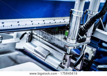 Metal industrial machinery and tools. Precise working process, device close-up.