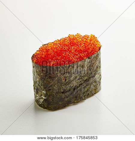 Japanese Sushi - Tobiko Gunkan Sushi (Nori wrapped Flying Fish Roe Sushi) on White Background