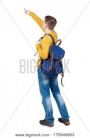 Back view of  pointing young men with backpack.  Young guy gesture. Rear view people collection.  backside view of person.  Isolated over white background. A tourist looks at something at the top