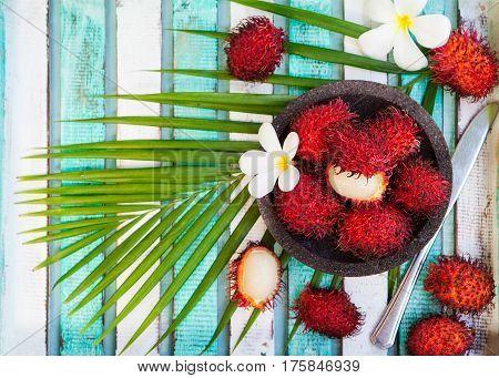 Fresh Rambutans In A Bowl. Copy Space. Top View
