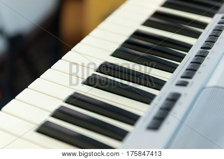 Close-up Of Piano Or Electronic Musical Keyboard Synthesizer