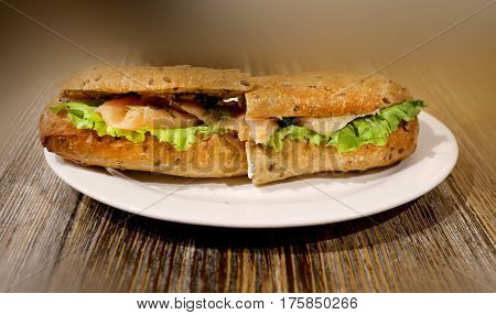 Photo of delicious big sandwich with fish