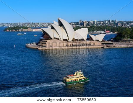 SYDNEY AUSTRALIA - March 122017: View of Sydney Opera House with ferry. Sydney Australia Over 10 millions tourists visit Sydney every year