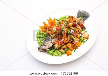 Fried Fish With Sweet And Sour Sauce On White Backgroung. Thai Food Style.