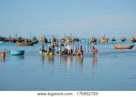 MUI NE, VIETNAM - DECEMBER 25, 2015: Blue morning in the harbour of the fishing village of Mui Ne. South Vietnam