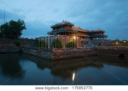 Midday gate of the imperial forbidden city in evening twilight. Hue, Vietnam