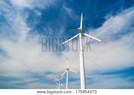 Wind Turbines  Against A Blue Sky Generating Electricity