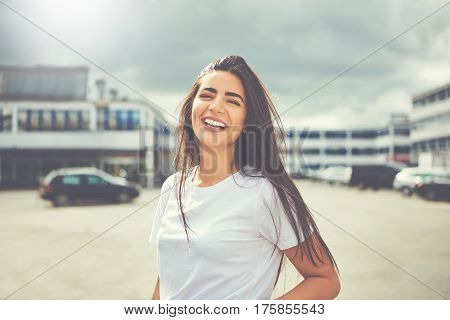 Laughing Woman In White Blouse And Long Hair