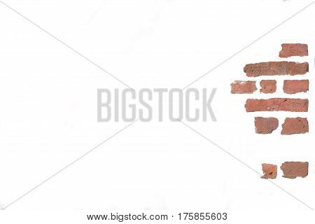 Some stone in a red stonewall is isolated over a white background