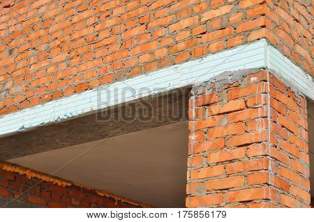 Close up on Thermal Bridge and Facade Wall Insulation. A thermal bridge also called a cold bridge or heat bridge in brick house wall insulation for house energy saving outdoor