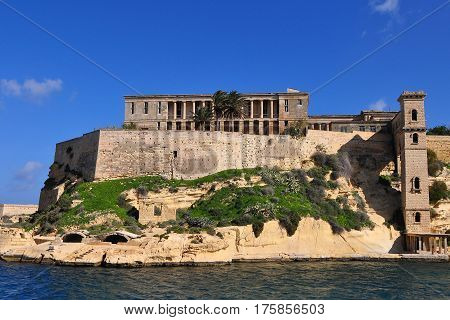 The mighty Fort St Angelo dominates Grand Harbour of Valetta, Malta