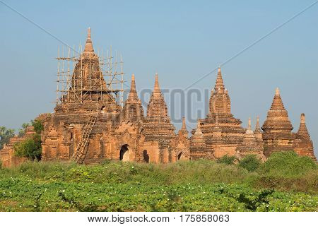 Restored ancient Buddhist temple complex in the vicinity of old Bagan. Myanmar