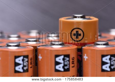 Alkaline batteries AA size with selective focus on single battery