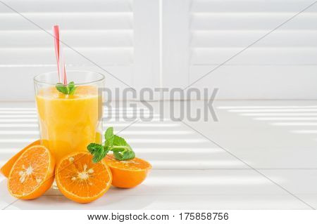 Fresh orange juice. Freshly blended fruit smoothies in glasses on a white wooden background. Fresh fruit cocktails. Diet concept.