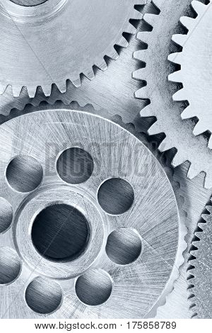 Different Metal Gear Cogwheels On Industrial Scratched Background