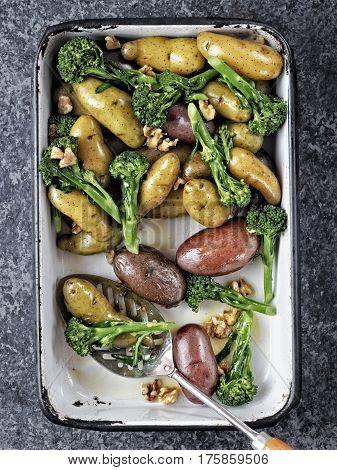 close up of a tray of potato broccolini salad