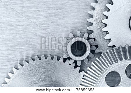 Mechanic Gear Cogwheels On Industrial Metal Background