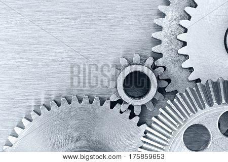 Mechanic Gear Cogwheels On Industrial Metal Background