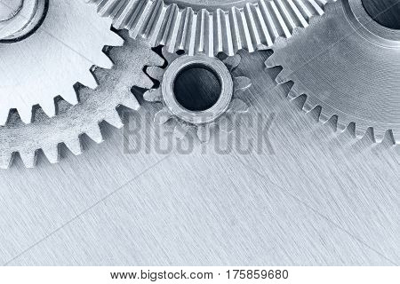 Set Of Industrial Metal Cogwheels On Scratched Background