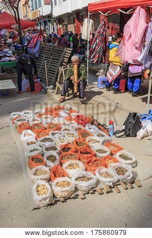 Yuanyang, China - February 21, 2017: Hani Man Smoking In The Shengcun Local Market In Yuanyang. Hani