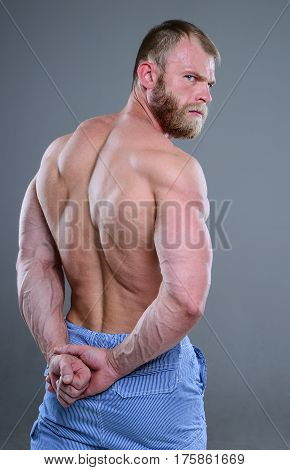 Brutal Muscular Man In Studio On Gray Background Fitness Model