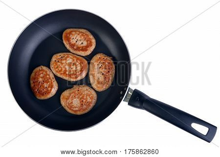 Frying pan with fritters isolated on the white top view