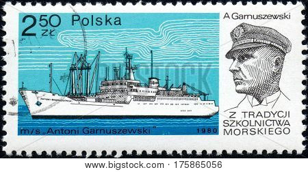 UKRAINE - CIRCA 2017: A stamp printed in POLAND shows Tradition Marine School captain Antoni Garnuszewski and Chip Antoni Garnuszewski circa 1980