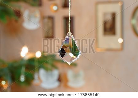 Bevelled Glass Crystal in front of Illuminated Christmas Tree Setting