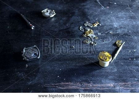 The watchmaker is repearing the mechancal watches