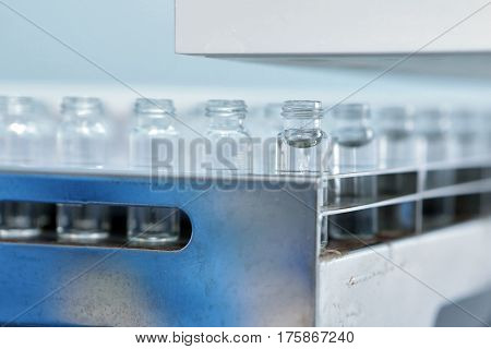 Sterile Capsules For Injection. Bottles On The Bottling Line Of The Pharmaceutical Plant. Machine Af