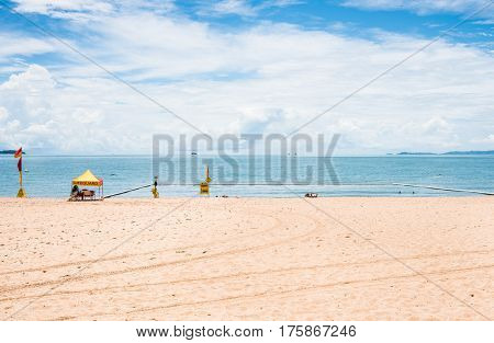 Swimming enclosure to protect from marine stingers and sharks on The Strand beach, Townsville, Australia poster