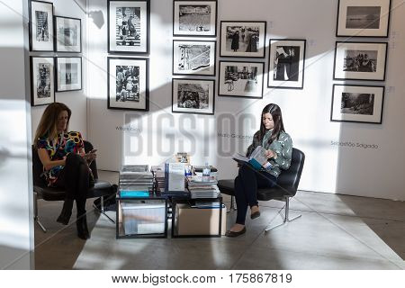 MILAN ITALY - MARCH 10: Exhibitors in their stand at MIA international photography and moving image art fair on MARCH 10 2017 in Milan.