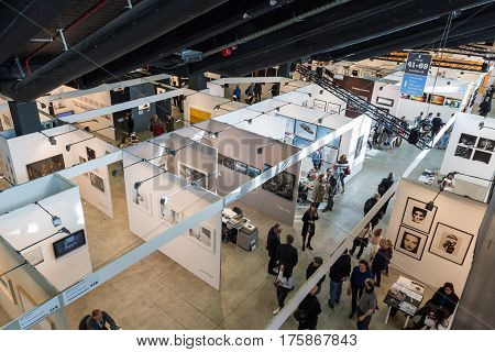 MILAN ITALY - MARCH 10: Top view of people and booths at MIA international photography and moving image art fair on MARCH 10 2017 in Milan.