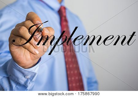 Businessman Writing Implement Word On Virtual Screen