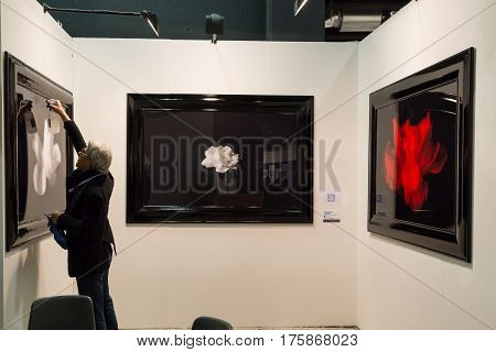 MILAN ITALY - MARCH 10: Exhibitor in his stand at MIA international photography and moving image art fair on MARCH 10 2017 in Milan.