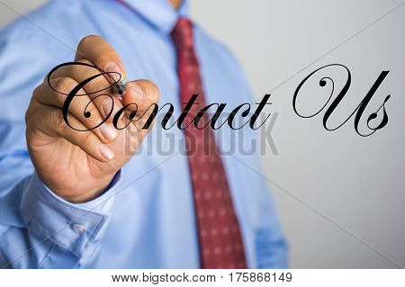 Businessman Writing Contact Us Word On Virtual Screen