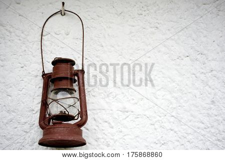 Light lamp hanging on the white wall