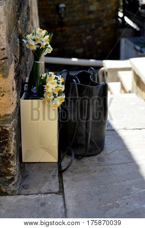 black bag and white yellow flower