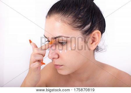 Girl Applying Facial Cream