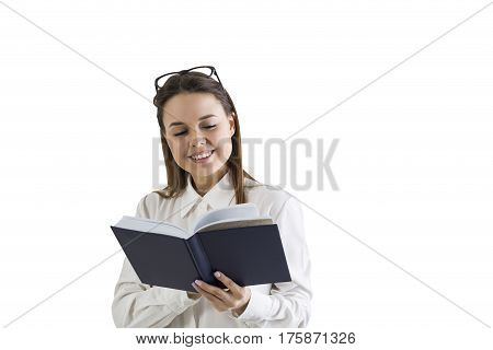 Isolated portrait of a cheerful woman holding a large black book. Concept of reading and working with information.