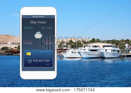 white phone with app mobile wallet and ship ticket against background sea with yachts