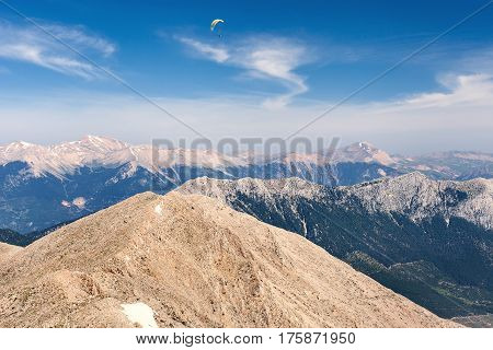 Flying paraglider in the sky on Turkey mountains