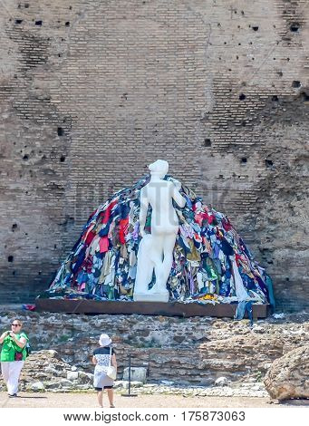Rome, Italy - July 12, 2013. The Colloseum, White Statue With Colored Clothes