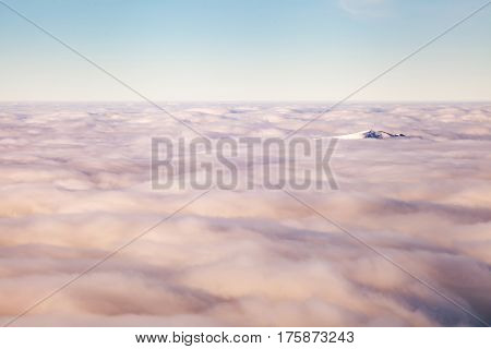 Winter landscape of the Carpathian Mountains in Ukraine. The top is tight fog and obscured by clouds.
