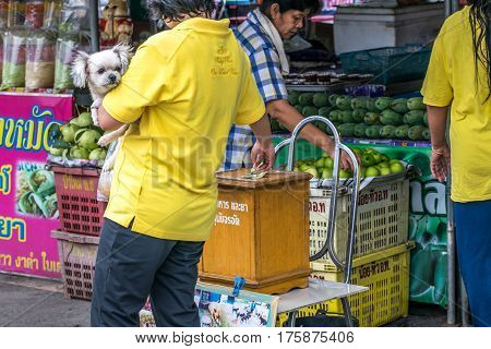 Woman Holding Her Dog Donating To Help Stray Dogs