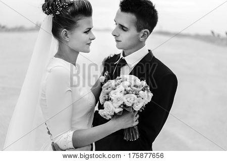 Stylish Bride And Groom At Sandy Coast Hugging, Luxury Wedding, Black And White
